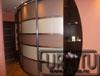 Радиусный шкаф купе в коридоре для верхней одежды