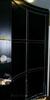 Радиусный шкаф купе черного цвета с серебренным кантом по всему периметру двери