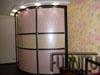 Радиусный шкаф с тремя дверьми. Выполнен в мягком розовом тоне  и темного дсп для спальни.